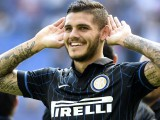 Inter Milan's Argentinian forward Mauro Icardi celebrates after scoring a 2nd goal during the Serie A football match Inter Milan vs Sassuolo, on September 14, 2014 in San Siro stadium in Milan. AFP PHOTO / OLIVIER MORIN        (Photo credit should read OLIVIER MORIN/AFP/Getty Images)