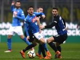 Napoli's forward Dries Mertens from Belgium (L) fights for the ball with Inter Milan's midfielder Roberto Gagliardini from Italy during the Italian Serie A football match between Inter Milan and Napoli on March 11, 2018, at the San Siro Stadium in Milan. / AFP PHOTO / MARCO BERTORELLO        (Photo credit should read MARCO BERTORELLO/AFP/Getty Images)